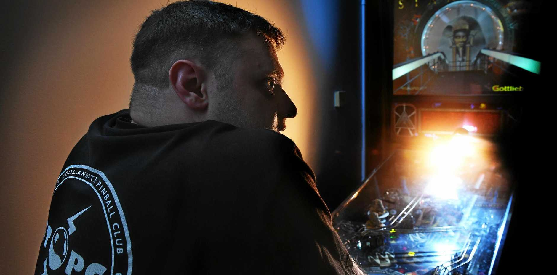 Travis Johnson, of Lismore, has competed in a pinball marathon, known as Death by Pinball - a 24 hour competition in Brisbane.
