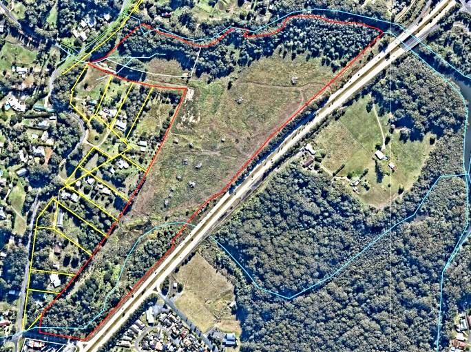 HIGHWAY ON ONE SIDE: The property on which the farm was proposed is outlined in red with the adjacent residential boundaries marked in yellow.