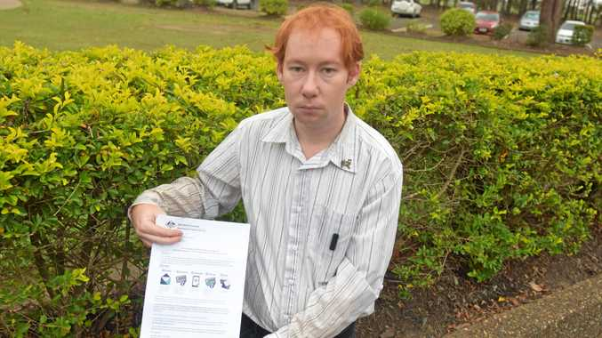 INCOMING: Bundaberg's Peter Feerick holding a letter he received about the Cashless Debit Card.