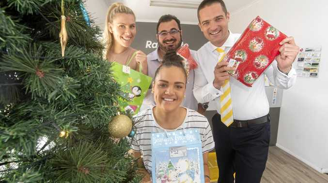 (back l-r) Courtney Smith, Lee Johns, Daniel Kelly and (front) Hayley Telfer of Ray White Yamba get into the giving spirit as part of their Little Ray of Giving Christmas presents appeal.