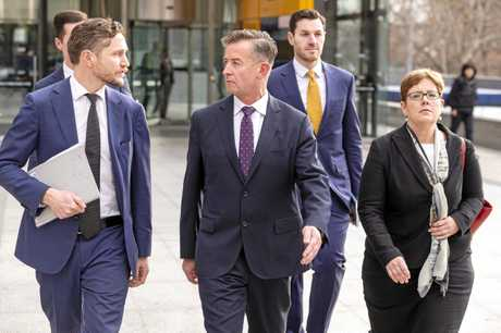 Head of Superannuation, ANZ, Mark Pankhurst (centre) leaves the Federal Court in Melbourne, Wednesday, August 15, 2018.