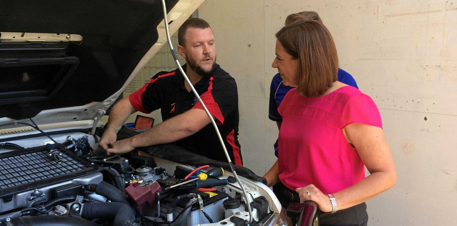 State Opposition Leader Deb Frecklington speaks with auto-electrician Michael Sugden during a visit of Battery Wise at Warana.