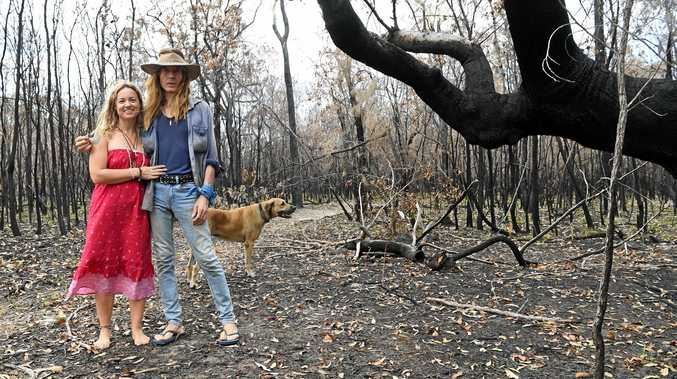 DEEPWATER FIRES: Amanda Heartsong and Laurie Rayment with Amanda's dog Rhani.
