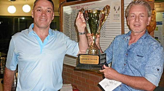 OUT ON TOP: Stanthorpe Golf Club president Stephen Kay presents the trophy for Men's Golfer of the Year to Scott Constable.