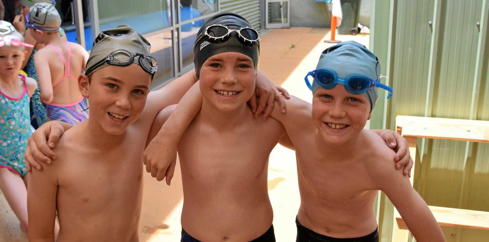 POOL MATES: Aiden Byrne, Thomas Albrand and Billy Bange at the St Mary's Catholic Primary School swimming carnival on Monday.