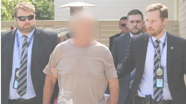 Chris Dawson is taken into custody. Picture: NSW police
