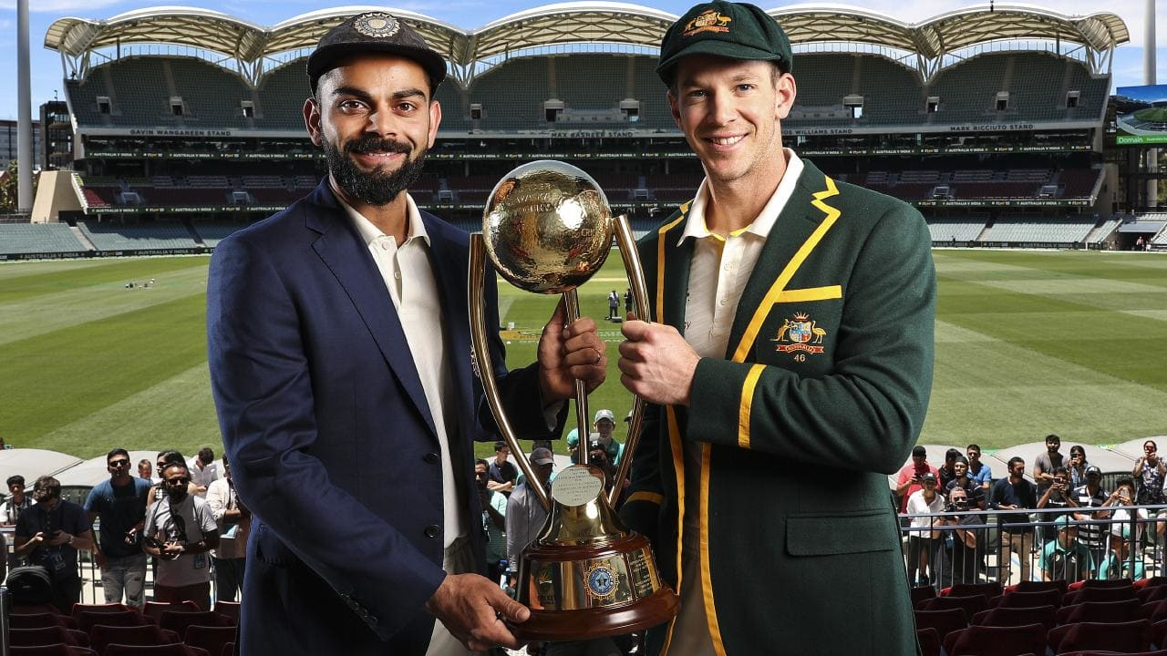 Tim Paine (right) and Virat Kohli hold the Border-Gavaskar Trophy. Picture: Sarah Reed