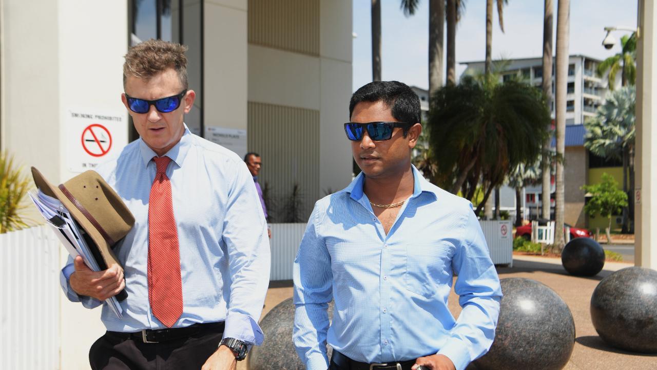 Keerthi Raja Eswaran (right) leaving Darwin Local Court. Picture: Keri Megelus