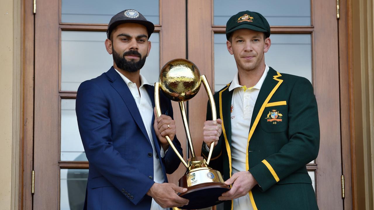 Australian captain Tim Paine (R) and Indian captain Virat Kohli pose with the Border Gavaskar trophy. Pic: AFP