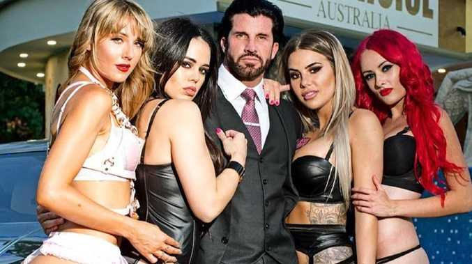 Travers Beynon with some women.