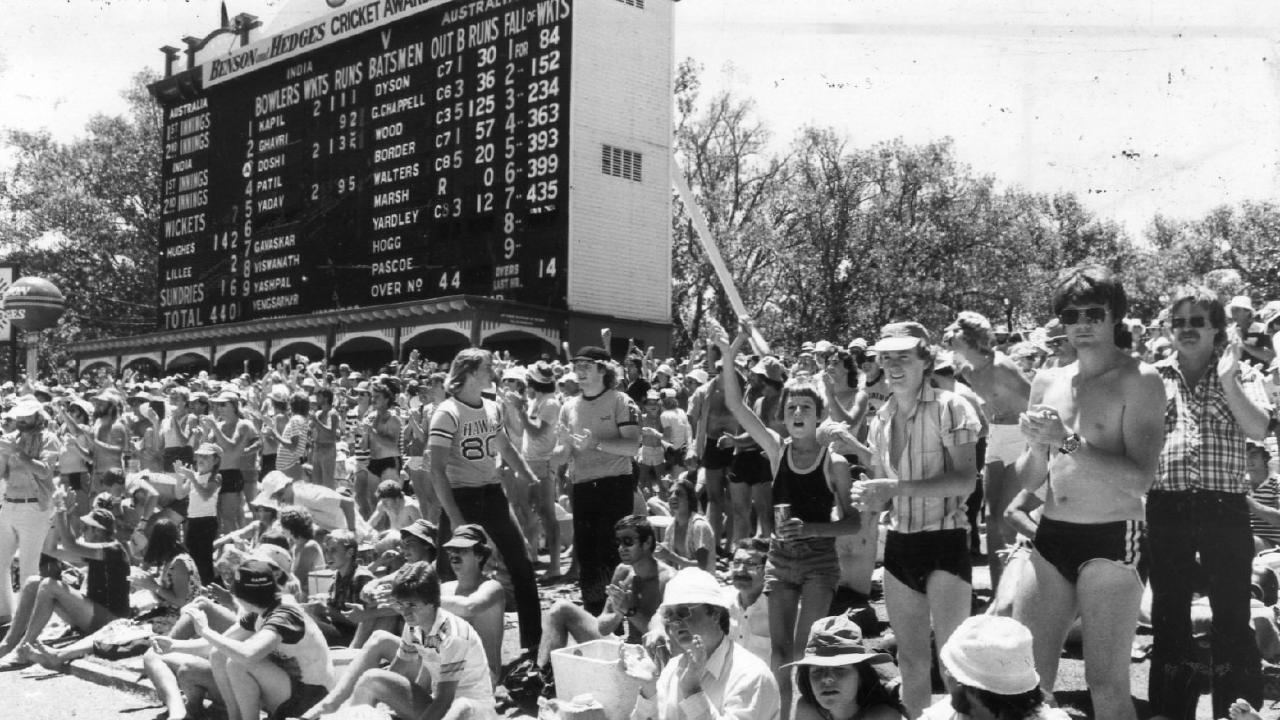 Fans on the hill in front of the iconic Adelaide scoreboard during the 1981 Test between Australia and India at the Adelaide Oval.