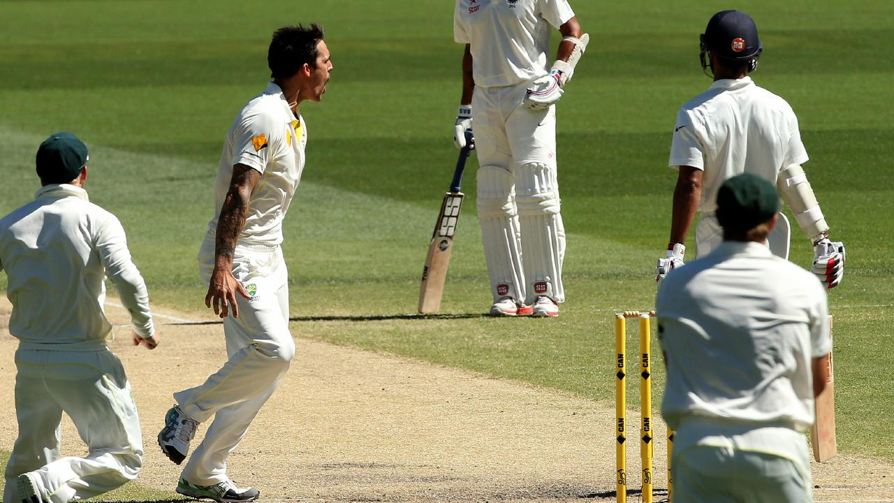 Mitchell Johnson celebrates the wicket of Shikar Dhawan on Day 5 of the 2014 Test against India. Picture: Simon Cross
