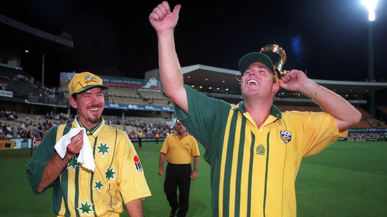 Ricky Ponting, sporting a rubbish goatee, and Shane Warne celebrate after winning the World Series Cup in 1996.