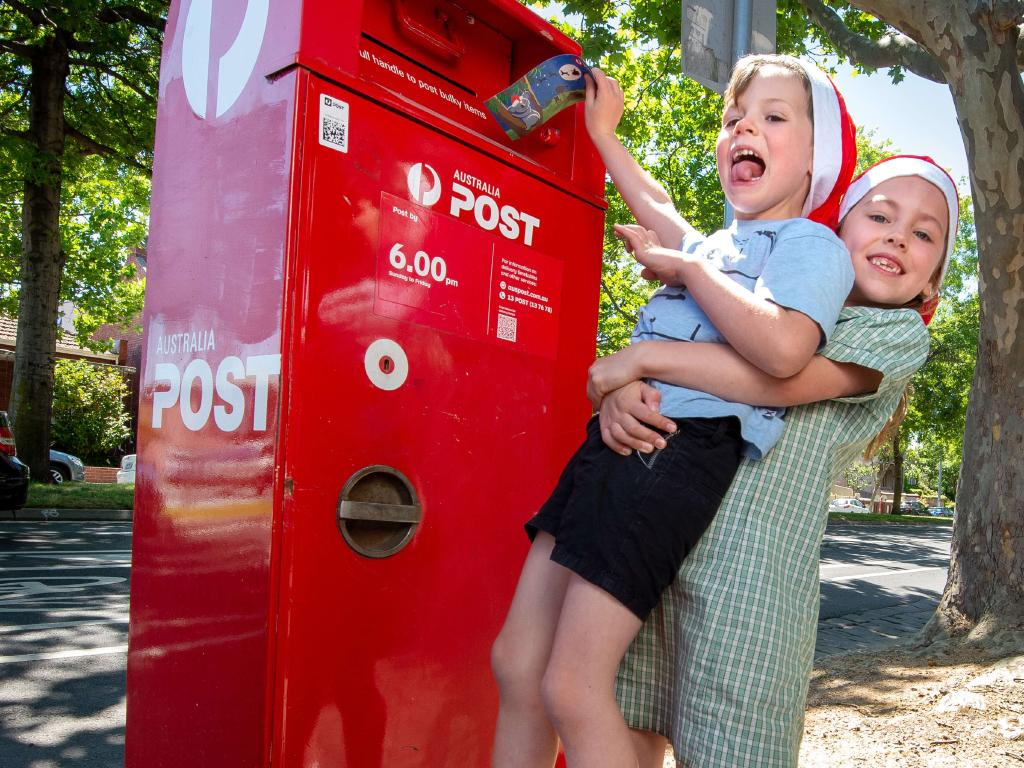 Brother and sister Ava (7) and Alfie (5) Brazel post a letter to Santa to promote Australia Posts Santa letter campaign kicking off. Picture: Jay Town.