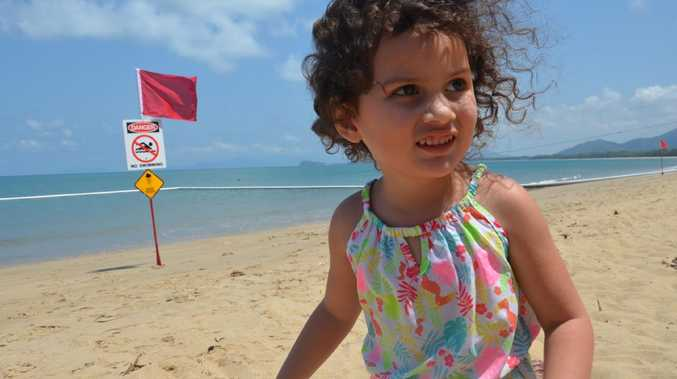 Nakita Bruce, 3, from Bentley Park, who has never been to the beach before, was disappointed she could not swim at Palm Cove, which has been closed due to irukandji jellyfish PICTURE: DANIEL BATEMAN