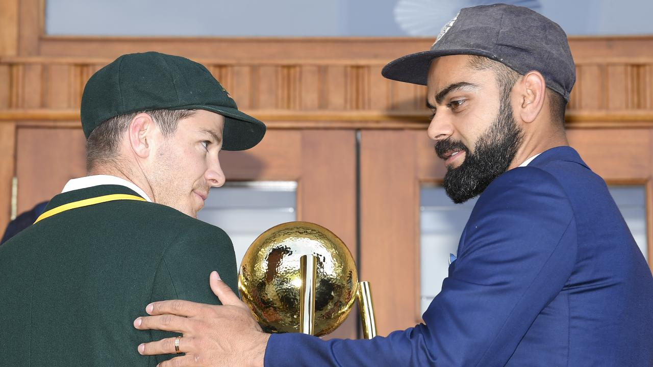 Kohli with Australian counterpart Tim Paine pose with the Border-Gavaskar trophy in Adelaide. Pic: AAP