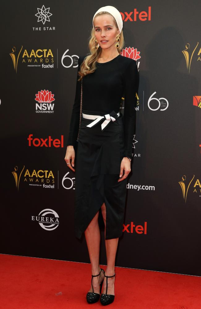 Isabel Lucas wore a a black and white body-hugging ensemble which showed off her slender figure. Picture: Richard Dobson