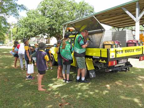 GENEROUS: Monogorilby State School students pack the Road Boss Rally vehicle with their Christmas gifts for GIVIT's Kids in Care Christmas Appeal on Wednesday December 5.