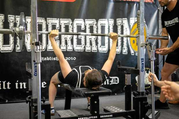 POWERFUL PERFORMANCE: National Bench Press Champion Fiona Flanders pushes through the national record.