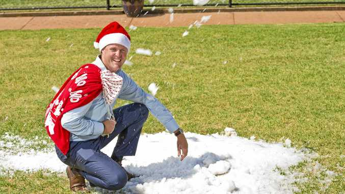 Toowoomba Turf Club chief executive officer Blair Odgers gets an early feel of the snow which is guaranteed to arrive at Clifford Park again tomorrow in time for the club's Vanderfield family Christmas day.
