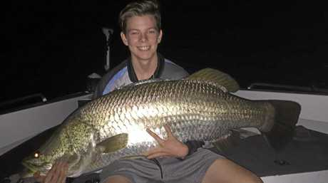 NEW PB: Keen young angler Caleb Starr caught and released this monster barramundi recently from a stocked impoundment. It went over a metre and was his new personal best.