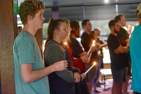 TRIBUTES: Friends and family hold a candlelight vigil for Jacob Mabb at the USC Rugby Club.