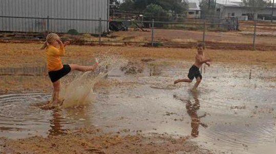 RAIN DANCE: Some children enjoy playing in the rain.