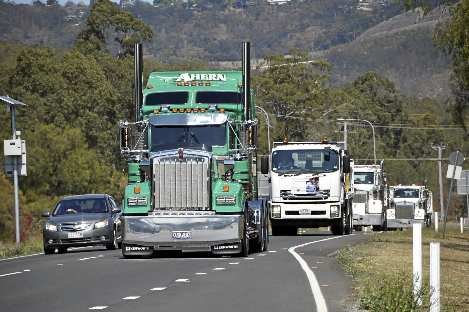 Convoy of trucks leave from Withcott for the annual Lights on the Hill memorial service in Gatton. September 2018