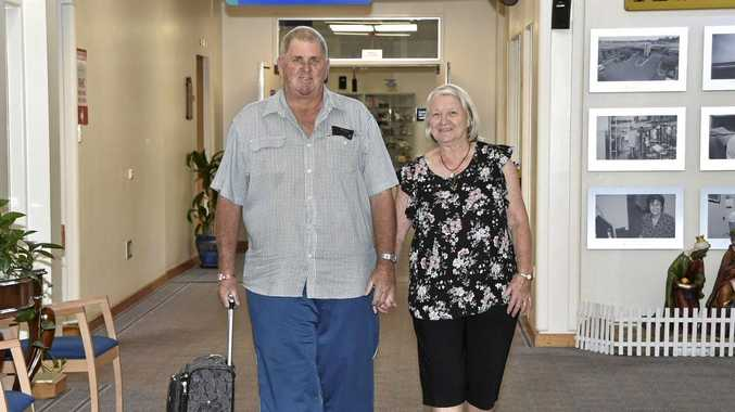 HEADING HOME: Ross and his wife June Olsson ready to leave St Andrew's Toowoomba Hospital yesterday, six days after Ross became part of medical history in Toowoomba, having had part of his liver removed by (inset) hepato-pancreato-biliary surgeon Dr Neil Wylie.