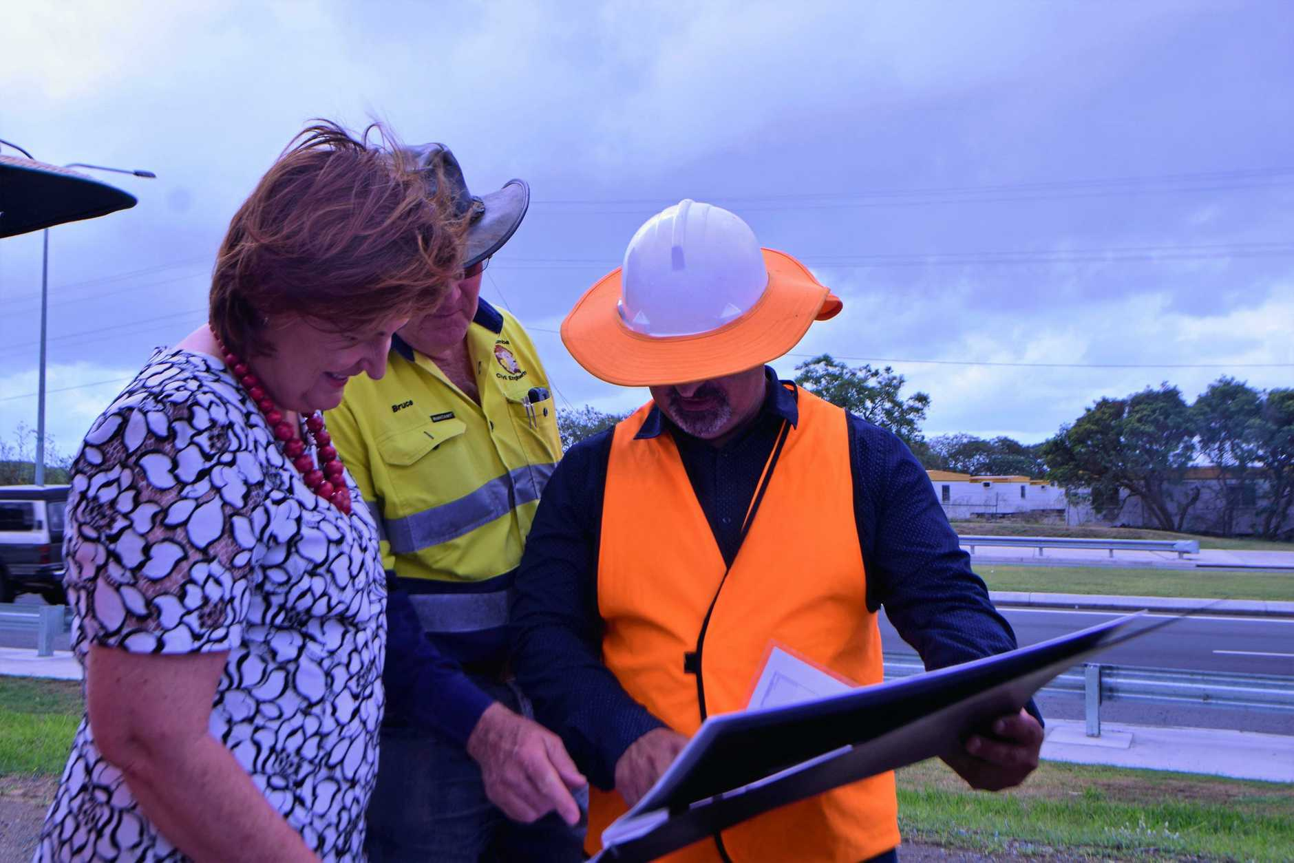 AHEAD OF SCHEDULE: Julieanne Gilbert discusses the new Vine Creek Bridge upgrade with engineers who worked on the project.