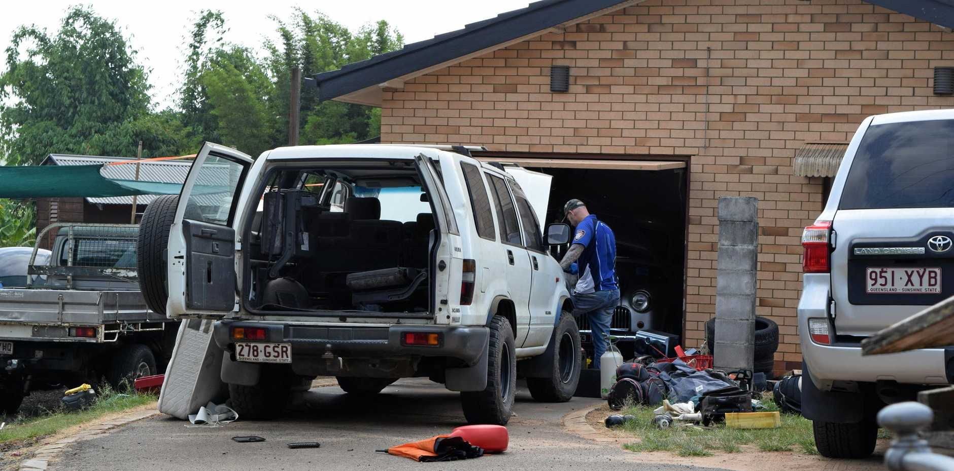 Multiple police officers in unmarked vehicles raided a Woombye home early Monday morning and arrested multiple people in relation to an alleged drug operation.