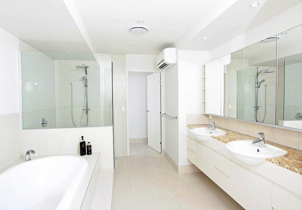 A bright, crisp white bathroom and ensuite.