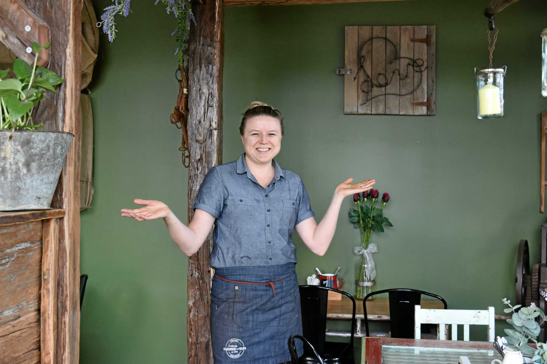 Sharla Watson in the new, renovated Farmer and Sun Cafe, which offers more space and an eclectic, rustic, vintage vibed decor.