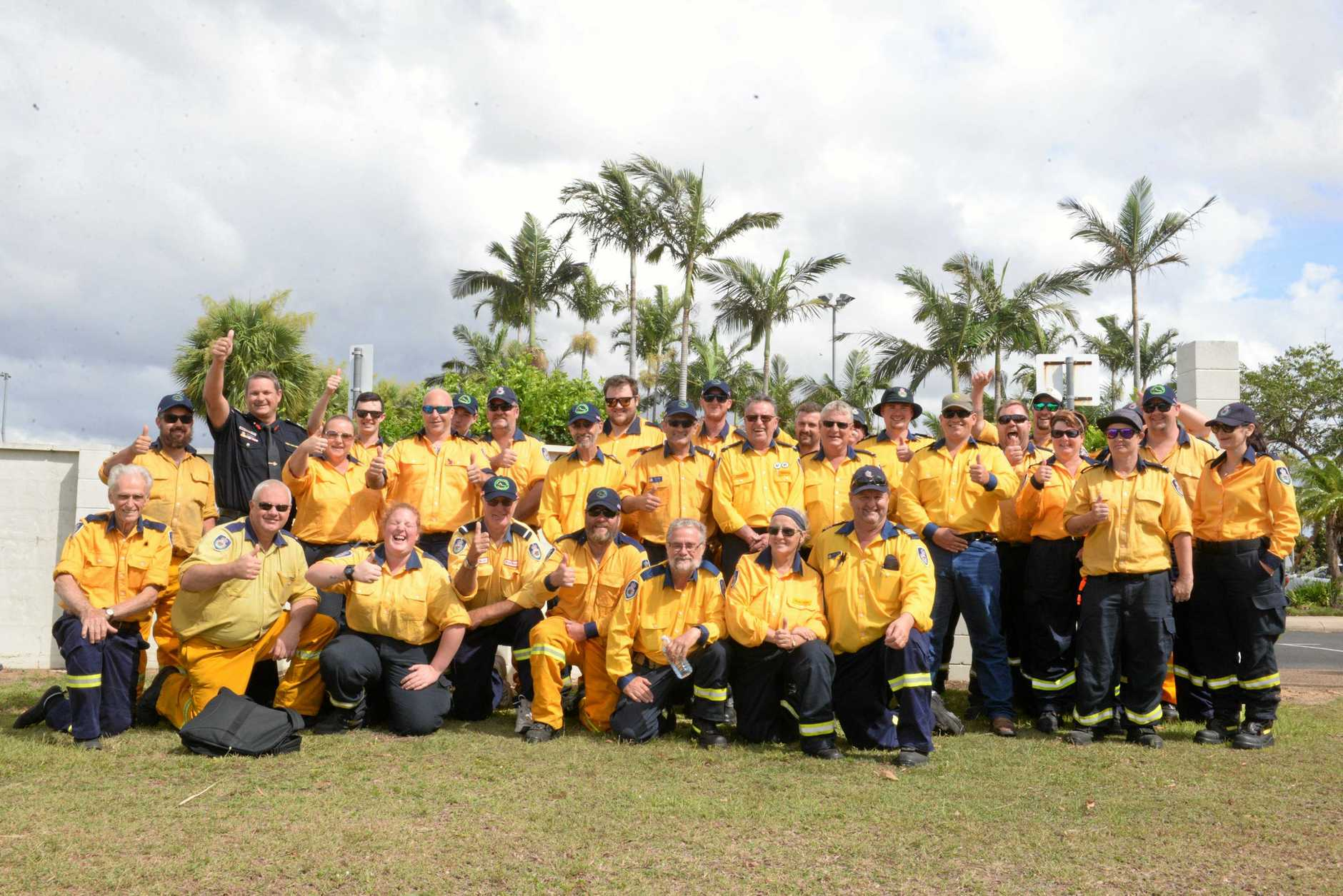 THANKFUL FAREWELL: Some of the NSW firefighters who flew out of Bundaberg this morning.