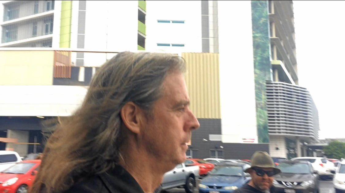 Geoffrey Robert Koll leaves the Maroochydore Courthouse after his first court appearance.