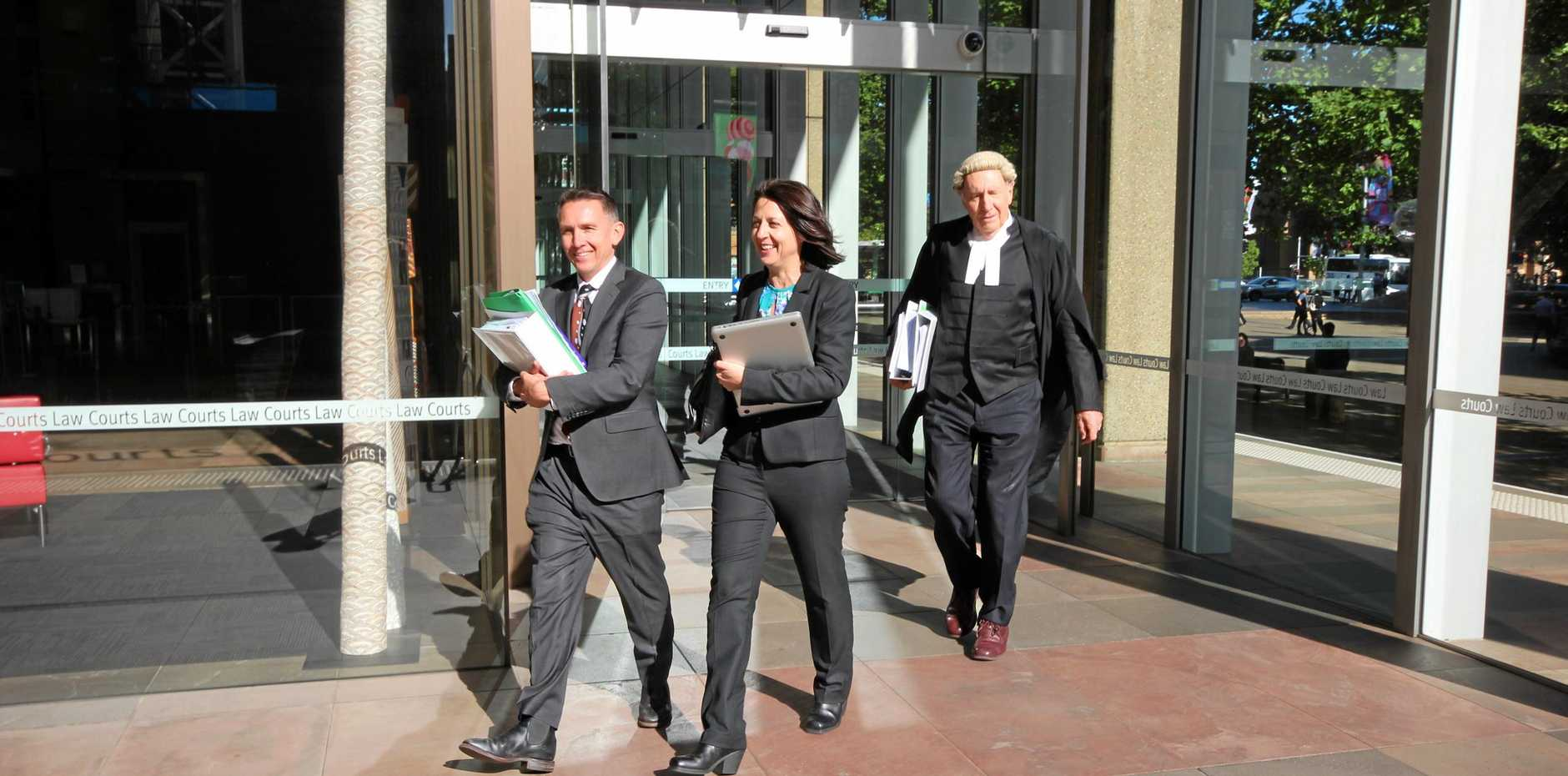 Esther Rockett (centre) leaves Sydney Supreme Court with solicitor Stewart O'Connell and barrister Tom Molomby after the final hearing in the defamation case brought against her by Universal Medicine leader Serge Benhayon.