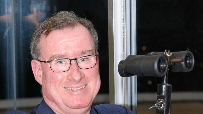 Ipswich greyhound race caller John Brasch.
