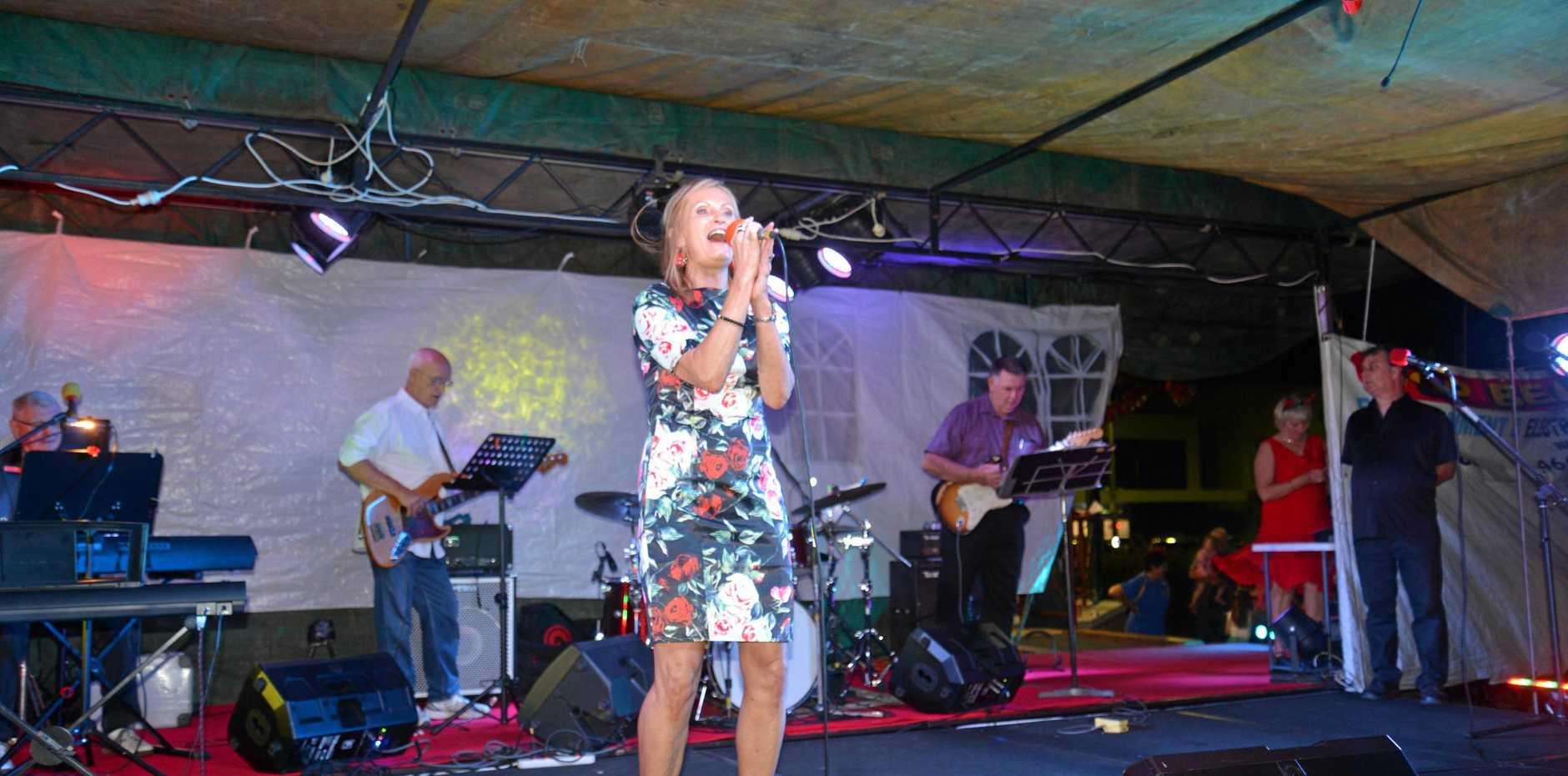 SPREADING CHEER: Erin Hilton performs at Carols in the Park, which draws thousands of people each year.