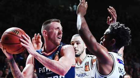 Mitch Creek in action for the Adelaide 36ers under pressure from Casper Ware of Melbourne United in game four of the 2018 NBL Grand Final series. Picture: Mark Brake/Getty Images
