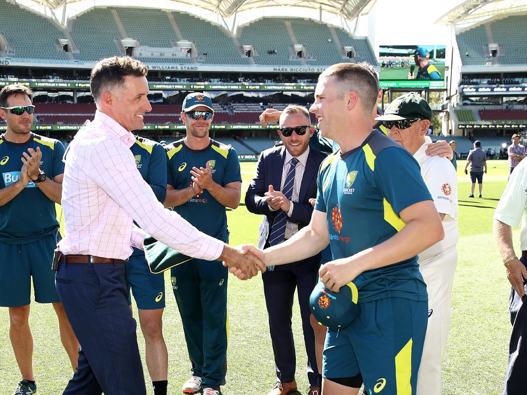 Mike Hussey congratulates Marcus Harris on earning his baggy green.