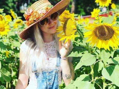 Toyah Cordingley loved sunflowers, which feature heavily in a new bumper sticker and poster campaign organised by her local community to help flush out her killers. Picture: Facebook