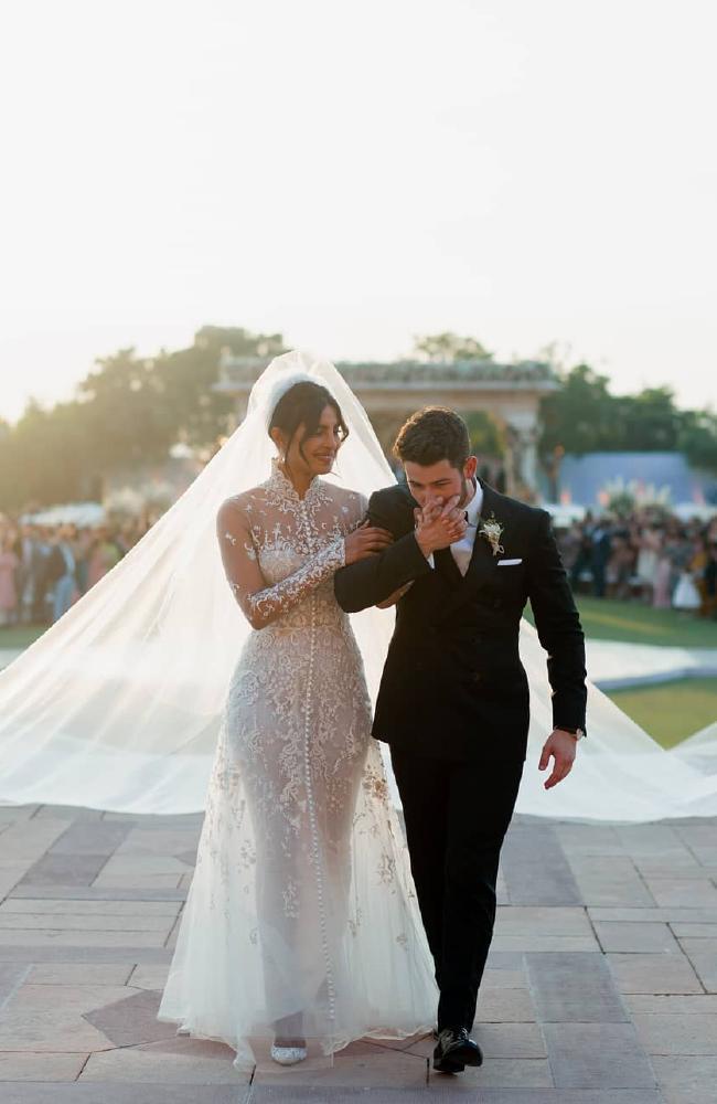 The bride's wedding dress featured an enormous veil.