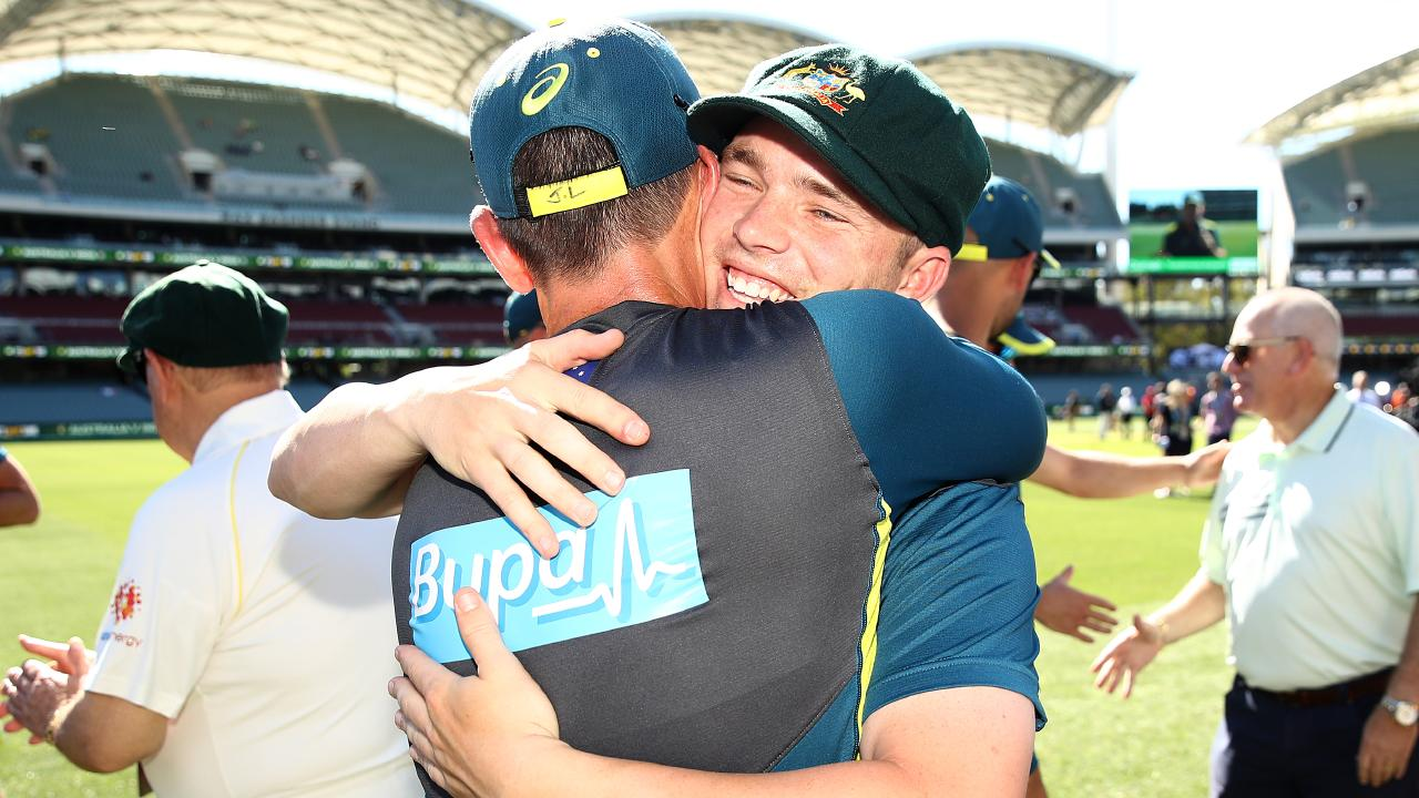 Marcus Harris hugs Australian coach Justin Langer after receiving his baggy green.