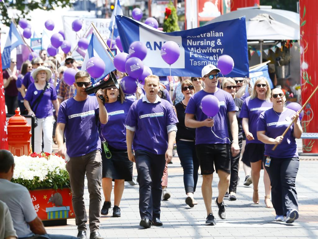 Nurse and midwifery union members walked from the Royal Hobart Hospital to Parliament Lawns to rally against the Government's pay offer. Picture: MATT THOMPSON