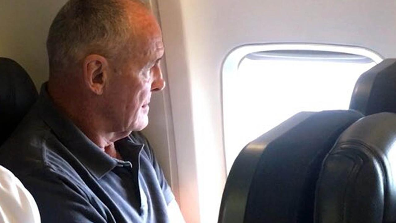 Mr Dawson on his flight to Sydney from Queensland after being extradited to NSW. Picture: Seven News