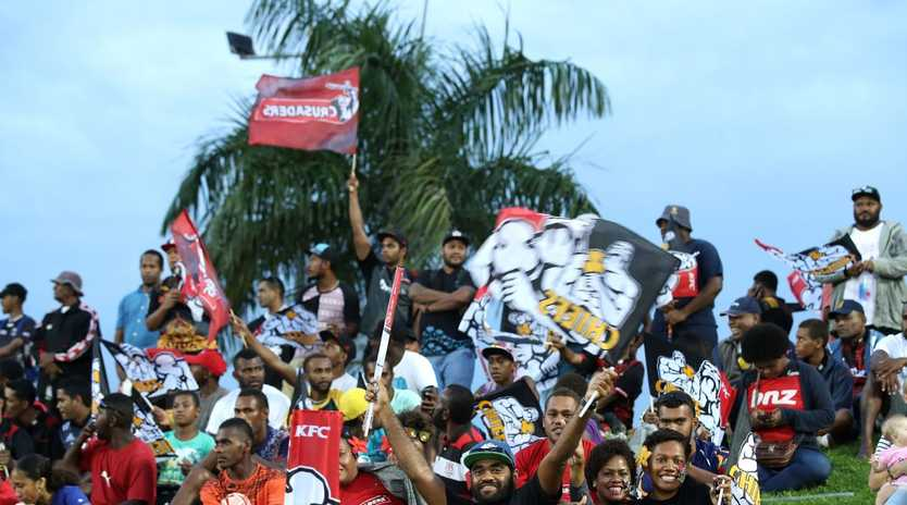 Fiji fans watch a Super Rugby game between the Chiefs and the Crusaders in Suva.
