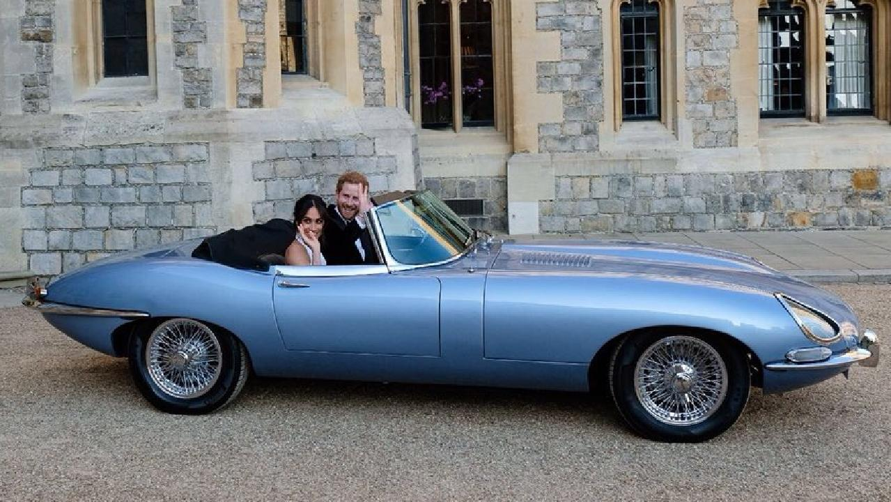 Prince Harry and Meghan Markle, Duchess of Sussex, leave Windsor Castle in a Jaguar E-Type after their wedding. Source: Kensington Palace Twitter