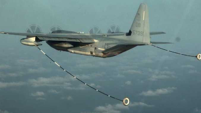 A KC-130 Hercules with its fuel lines extended. An aircraft similar to this has collided with a F/A-18D off the coast of Japan. Picture: US Marines