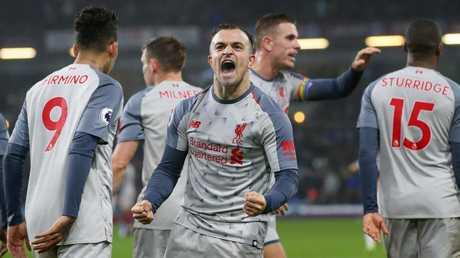 Xherdan Shaqiri of Liverpool celebrates. (Photo by Alex Livesey/Getty Images)
