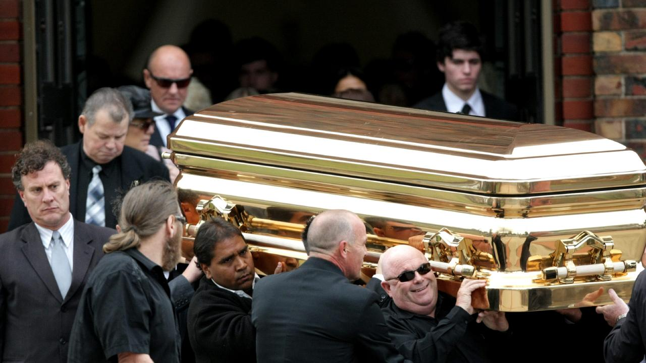 The gold coffin with the body of Williams leaves his funeral service.
